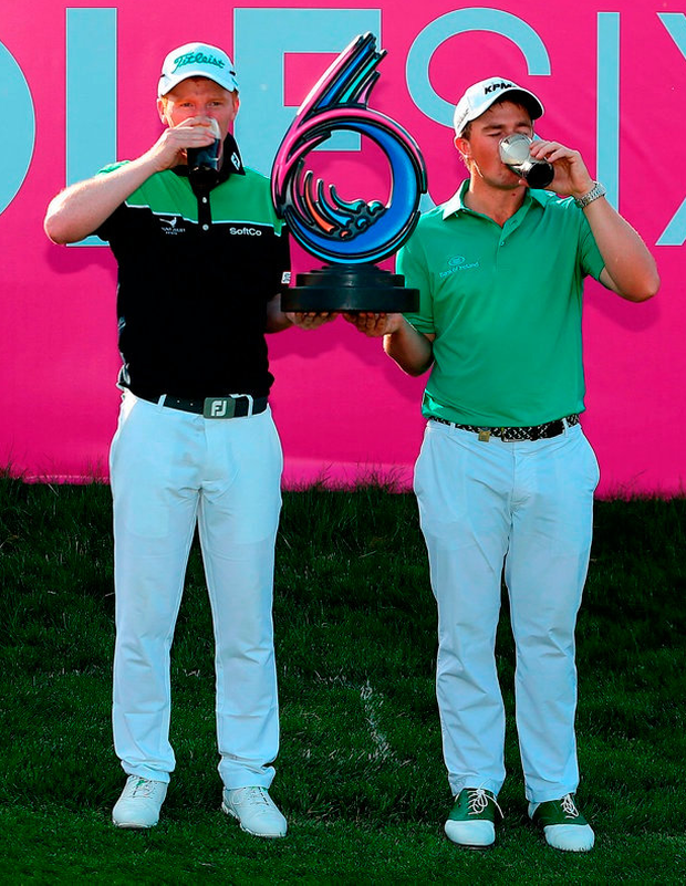 Gavin Moynihan and Paul Dunne celebrate their Golf Sixes triumph. Photo: Steven Paston/PA