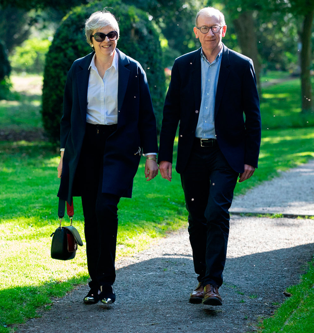 Theresa May and husband Philip leave after a church service near Maidenhead yesterday. Photo: PA