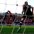 Olivier Giroud wins a header to score the winning goal for Chelsea against Liverpool. Photo by Clive Rose/Getty Images