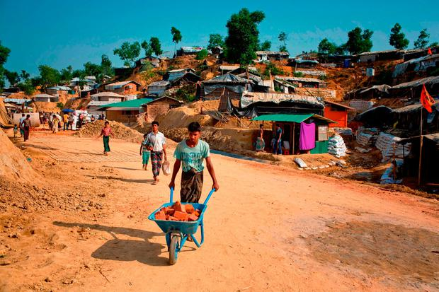 Rohingya refugees rebuild their makeshift homes in preparation for the approaching monsoon season at the Rohingya refugee camp in Kutupalong. Photo: AP