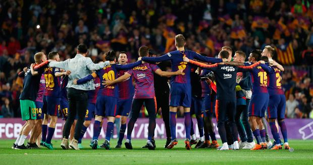 Barcelona players celebrate at the end of their 2-2 draw against Real Madrid which maintained their unbeaten record in La Liga with one game remaining. Photo: Reuters