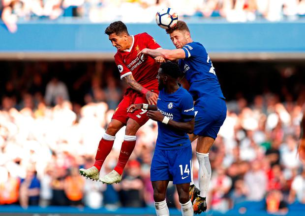 Chelsea's Gary Cahill and Tiemoue Bakayoko in action with Liverpool's Roberto Firmino. Photo: Reuters/John Sibley