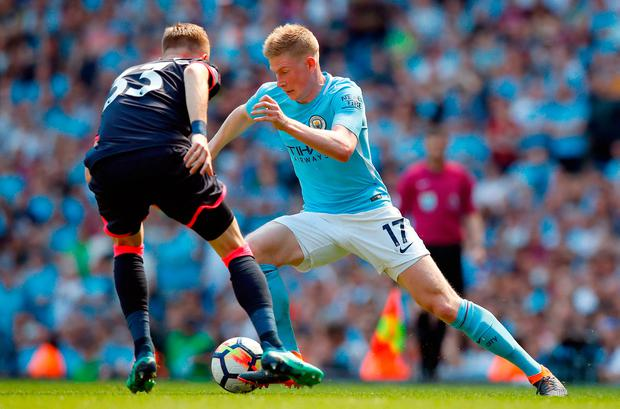 Manchester City's Kevin De Bruyne (right) and Huddersfield Town's Florent Hadergjonaj in action. Photo credit: Martin Rickett/PA Wire