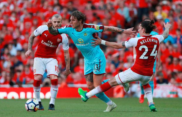 Burnley's Jeff Hendrick in action with Arsenal's Hector Bellerin and Jack Wilshere. Photo: Reuters