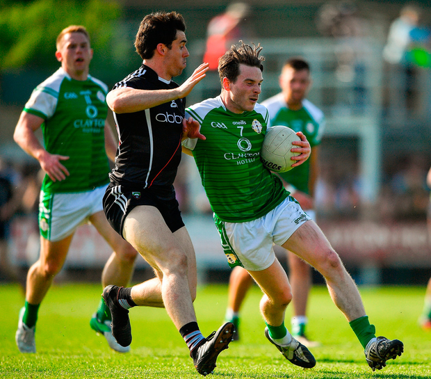London's Patrick Begley in action against Darragh Cummins of Sligo. Photo: Harry Murphy/Sportsfile