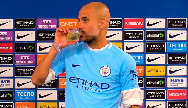 BUBBLY: Manchester City manager Pep Guardiola drinks champagne in the post match press conference. Photo: PA