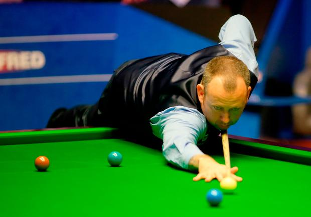 Mark Williams in action at the 2018 Betfred World Championship at The Crucible yesterday. Photo: Richard Sellers/PA