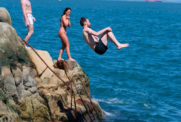Swimmers at the Forty Foot in Dublin. Photo: Stephen Collins
