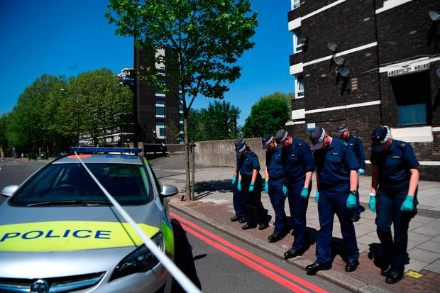 Police officers comb the cordoned area in Camberwell New Road, Southwark, south London, as 17-year-old Rhyhiem Ainsworth Barton was shot dead at Warham Street on Saturday evening after officers were called to reports of gunshots on nearby Cooks Road. Victoria Jones/PA Wire