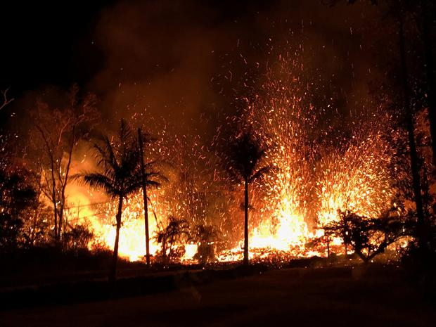 A new fissure spraying lava fountains as high as about 230 feet (70 m), according to United States Geological Survey, is shown from Luana Street in Leilani Estates subdivision on Kilauea Volcano's lower East Rift Zone in Hawaii, U.S., May 5, 2018. Photo taken May 5, 2018. US Geological Survey/Handout via REUTERS ATTENTION EDITORS - THIS IMAGE WAS PROVIDED BY A THIRD PARTY.