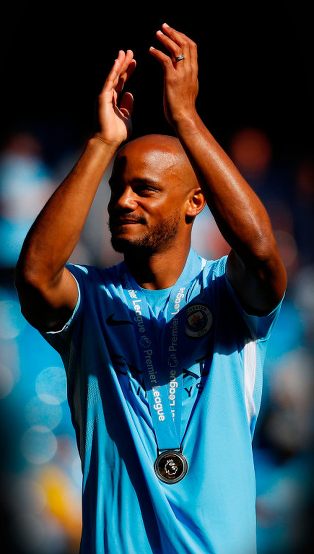 CHAMPIONS AGAIN: Manchester City captain Vincent Kompany celebrates after his side lifted the Premier League title at the Etihad last Sunday. Photo: Reuters