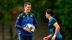 Johnny Sexton and Joey Carbery warm up during training in UCD yesterday. Photo: Sportsfile