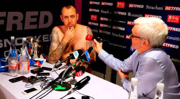 Mark Williams conducts his post match interview without any clothes after winning the 2018 Betfred World Championship at The Crucible, Sheffield: Richard Sellers/PA Wire