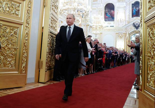 Russian President Vladimir Putin walks to his inauguration ceremony at the Kremlin in Moscow yesterday. Photo: Mikhail Metzel