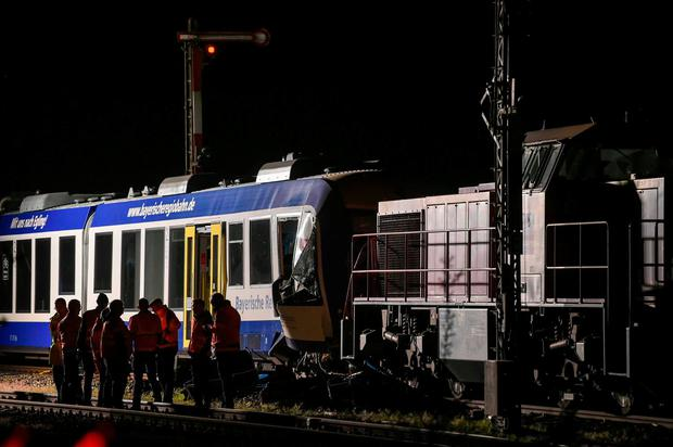 Firefighters and rescuers work at the scene where two trains collided on late May 7, 2018 in Aichach, killing two people and Injuring several others. The Deutsche Bahn network operator said that a commuter service hit a freight train between Ingolstadt and Augsburg in Germany's southern Bavaria region. / AFP PHOTO / Christof STACHECHRISTOF STACHE/AFP/Getty Images