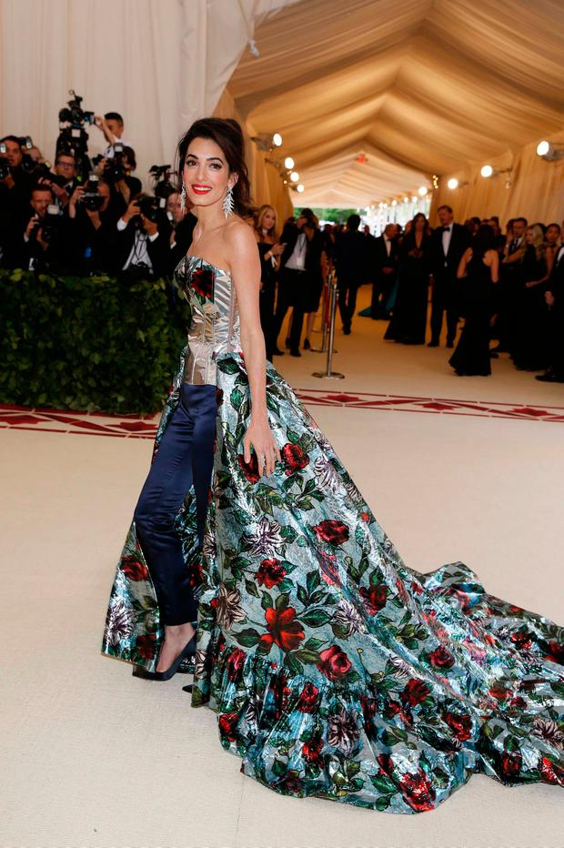 "Amal Clooney arrives at the Metropolitan Museum of Art Costume Institute Gala (Met Gala) to celebrate the opening of ""Heavenly Bodies: Fashion and the Catholic Imagination"" in the Manhattan borough of New York, U.S., May 7, 2018. REUTERS/Carlo Allegri"