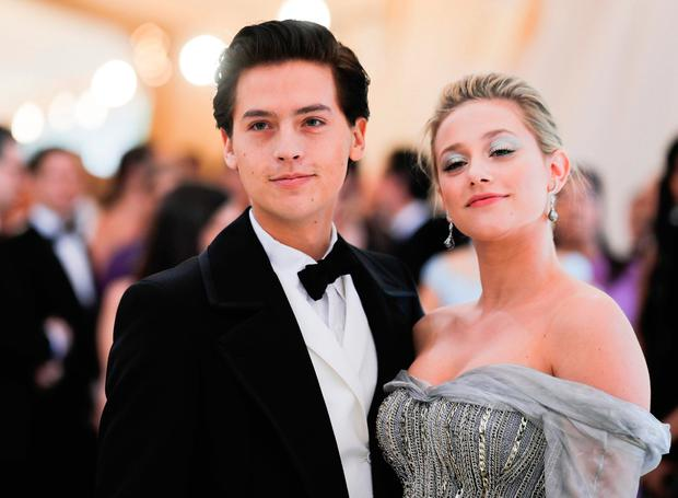 """Lili Reinhart and Cole Sprouse arrive at the Metropolitan Museum of Art Costume Institute Gala (Met Gala) to celebrate the opening of """"Heavenly Bodies: Fashion and the Catholic Imagination"""" in the Manhattan borough of New York, U.S., May 7, 2018. REUTERS/Carlo Allegri"""