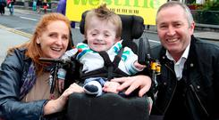Michael Stokes with his foster parents Ann Higgins and Barry McCabe at Croke Park in 2012. Photo: Arthur Carron/Collins