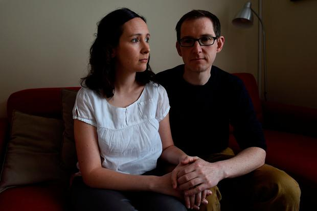 Amy Callahan with her partner Connor Upton at their home in Dublin. Photo: Clodagh Kilcoyne