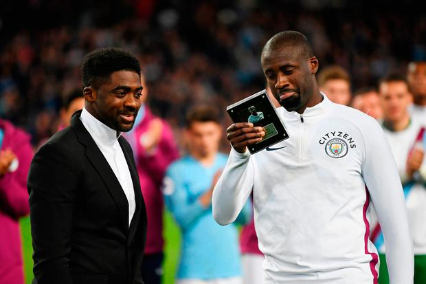 Yaya Toure shows his appreciation to the Manchester City fans as his brother Kolo looks on. Photo: Getty