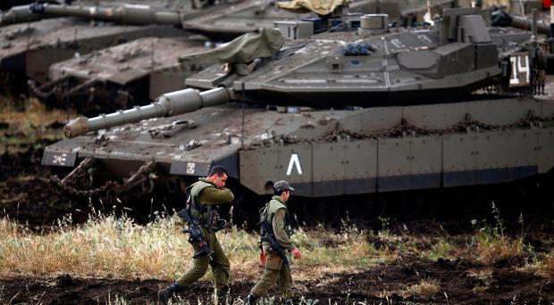 Syrian state media says dozens of Israeli rockets fired into Syria