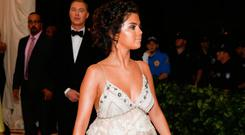 """Singer Selena Gomez arrives at the Metropolitan Museum of Art Costume Institute Gala (Met Gala) to celebrate the opening of """"Heavenly Bodies: Fashion and the Catholic Imagination"""" in the Manhattan borough of New York, U.S., May 7, 2018. REUTERS/Carlo Allegri"""