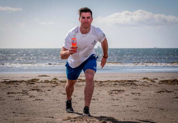 Dublin midfielder Michael Darragh Macauley at the launch of Fanta Sandstorm's beach run on Dollymount Strand. Photo credit ©INPHO/Ryan Byrne