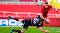 Rory Scannell is tackled by James Johnston. Photo by Sam Barnes/Sportsfile