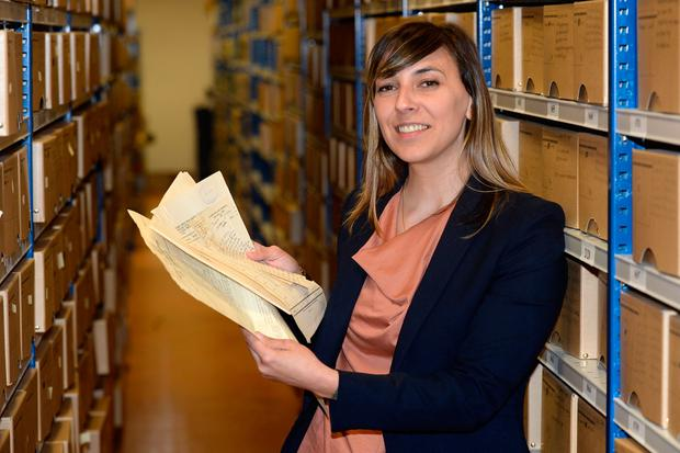 Cecile Gordon, project manager of the military pension project in Cathal Brugha Barracks, Dublin, with some of the released files. Photo: Justin Farrelly