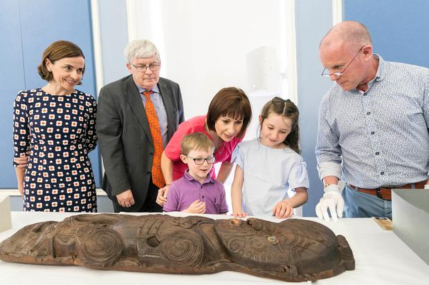 Pictured at the launch at the NMI, National Decorative Arts & History, Collins Barracks, was (from L-R) Catherine Heaney, Chair of the NMI Board, Raghnall Ó 'Floinn, Director NMI Minister for Culture, Heritage and the Gaeltacht Josepha Madigan TD, Sophie (8) & Evan (5) O'Connor, Patrick Boyle, Conservator NMI, looking at museum artifacts. Photo: Paul Sherwood