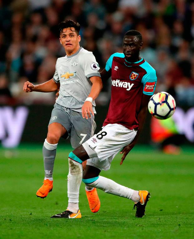 Manchester United's Alexis Sanchez (left) and West Ham United's Cheikhou Kouyate in action. Photo credit: Nick Potts/PA Wire