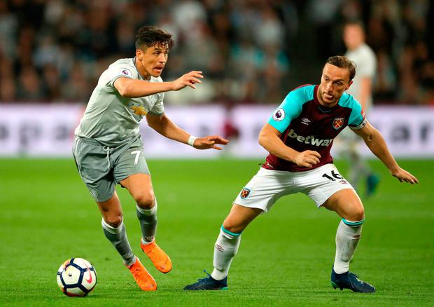 Manchester United's Alexis Sanchez (left) and West Ham United's Mark Noble battle for the ball. Photo credit: Nick Potts/PA Wire