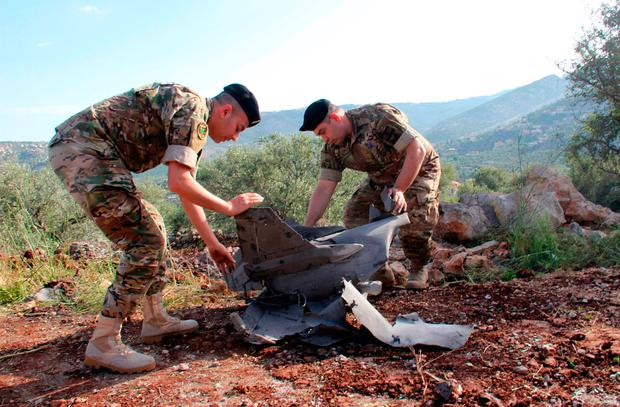 Lebanese soldiers inspect remains of a missile that landed in the southern Lebanese village of Hebarieh. Photo: Getty Images