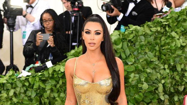Kim Kardashian West has said she is still rooting for her sister Khloe's relationship - despite cheat claims (Ian West/PA)