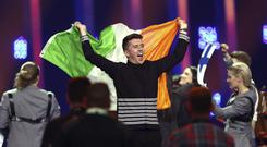 Ryan O'Shaughnessy from Ireland celebrates after securing a place in the Eurovision Song Contest final (Armando Franca/AP)