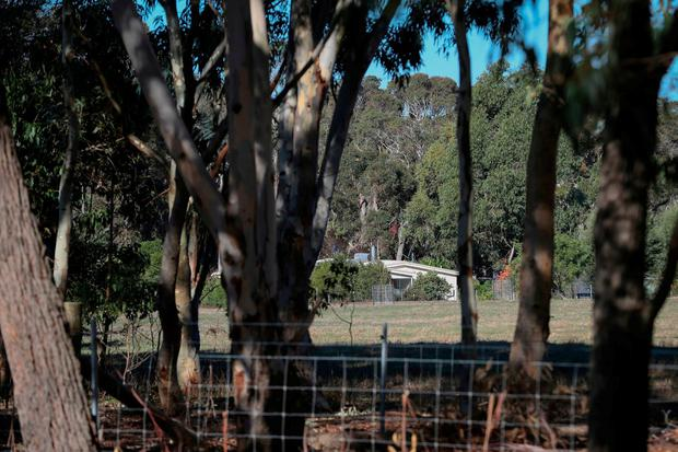 A property is seen from a police roadblock where police are investigating the death of seven people in a suspected murder-suicide in Osmington, east of Margaret River, 162 miles (260 kms.) south west of Perth, Friday, May 11, 2018. Seven people including four children were found dead with gunshot wounds at a rural property in southwest Australia in what could be the country's worst mass shooting in 22 years. (Richard Wainwright/AAP Image via AP)