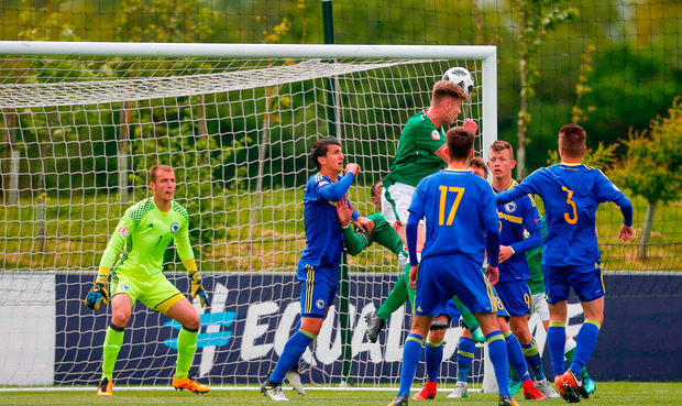 Nathan Collins of Ireland wins a header but his goal is disallowed