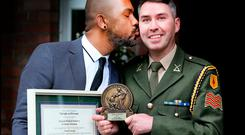 Pictured receiving a kiss from his Husband Levino Oliveira at the inaugural Defence Forces Values Champions Awards at the UN Training School, The Curragh, Co. Kildare was Sgt. Richard Muldarry Pic Steve Humphreys