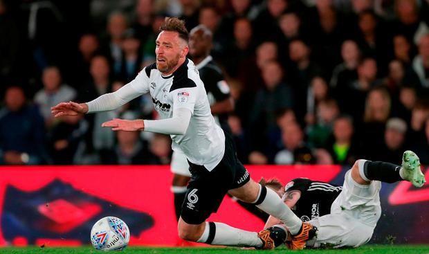 Derby County's Richard Keogh (left) is brought down during the Sky Bet Championship Playoff match at Pride Park