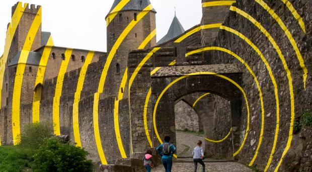 Locals see red over 'filthy' artwork daubed on castle