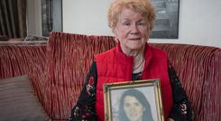 Sheelagh Mullany holds a picture of her daughter Antoinette, who died from ovarian cancer.