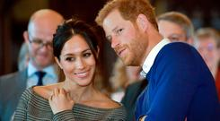 Britain's Prince Harry and his fiancée US actress Meghan Markle. Photo: Ben Birchall/AFP/Getty Images