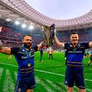 Isa Nacewa, left, and Jonathan Sexton of Leinster lift the Cup and celebrate after the European Rugby Champions Cup Final match between Leinster and Racing 92 at the San Mames Stadium in Bilbao, Spain. Photo by Ramsey Cardy/Sportsfile