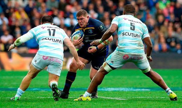 Tadhg Furlong of Leinster takes on Vasil Kakovin of Racing 92 and Leone Nakarawa of Racing 92 during the European Rugby Champions Cup Final match between Leinster Rugby and Racing 92 at San Mames Stadium on May 12, 2018 in Bilbao