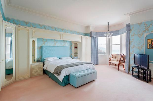 The master bedroom at Summerhill with view over the bay