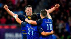 James Ryan of Leinster celebrates with team-mates Jamison Gibson-Park and Jonathan Sexton after the European Rugby Champions Cup Final match between Leinster and Racing 92 at the San Mames Stadium in Bilbao, Spain. Photo by Brendan Moran/Sportsfile