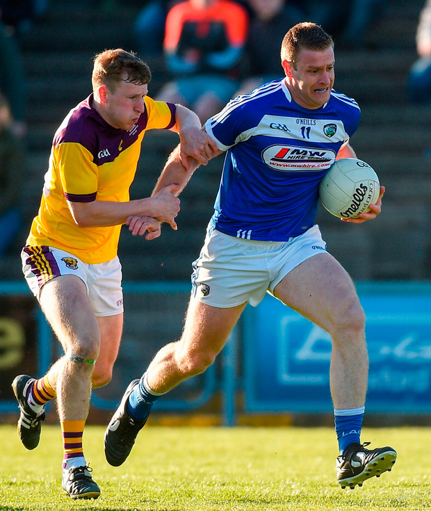 Donal Kingston of Laois in action against Wexford's Michael Furlong. Photo: Matt Browne/Sportsfile