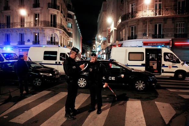 Policemen stand guard in a street of Paris centre after the attack Photo: Getty Images