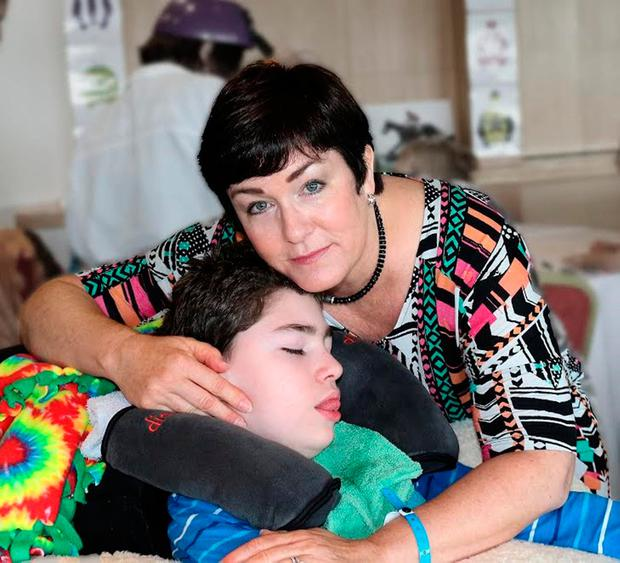 PLEA FOR HELP: Tracy McGinnis with her 13-year-old severely disabled son, Brendan. Photo: Colm Quinn