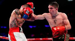 Michael Conlan punches Ibon Larrinaga during their featherweight fight at Madison Square Garden on May 12, 2018 in New York City. (Photo by Al Bello/Getty Images)